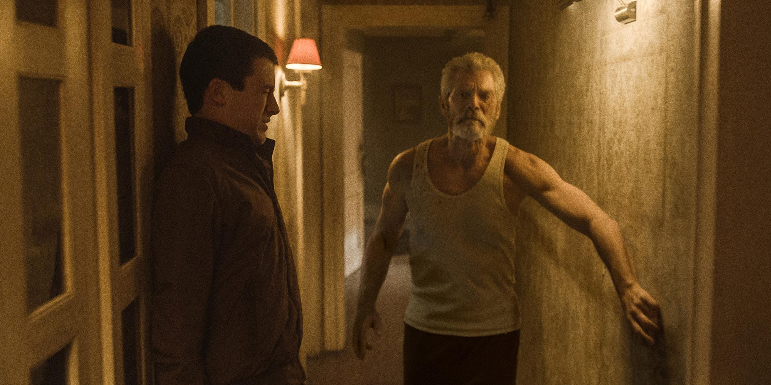 Dylan Minnette (left) and Stephen Lang star in Screen Gems' horror-thriller DON'T BREATHE.
